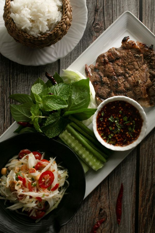 Ma Maison : Thinly sliced grilled Australian Angus rib eye or grilled pork with hot and sour sauce, served with sticky rice and green papaya salad